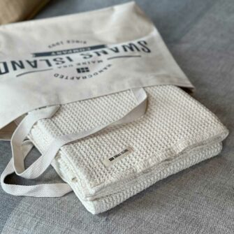 Swans Island's Waffle Knit Throw blanket is woven in Maine with 100% American cotton.